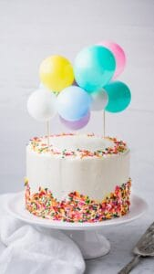 Homemade Confetti Cake with Vanilla Buttercream Frosting and DIY Balloon Cake Topper
