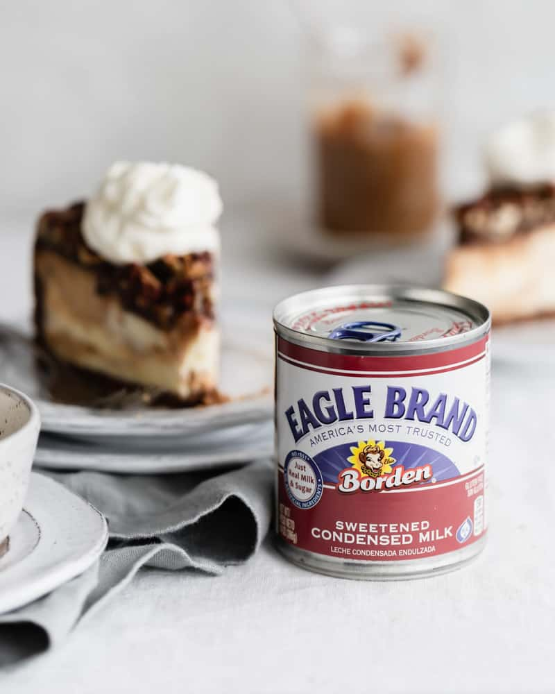 Slices of pecan pie cheesecake with Eagle Brand sweetened condensed milk can