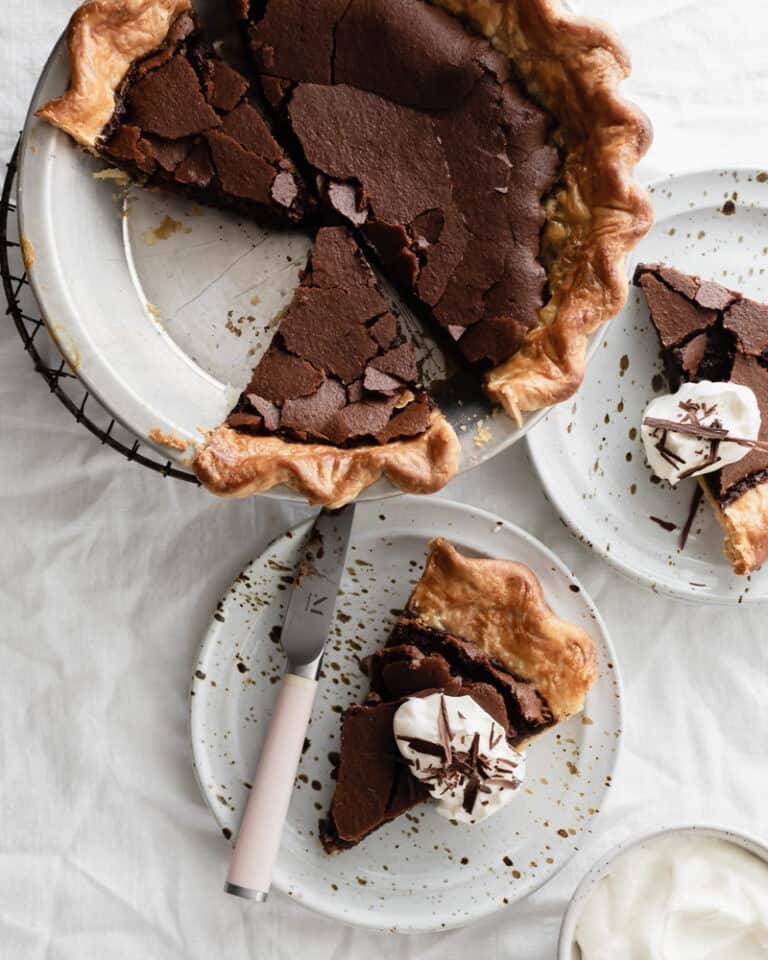 Fudgy Dark Chocolate Chess Pie ready to be served with whipped cream