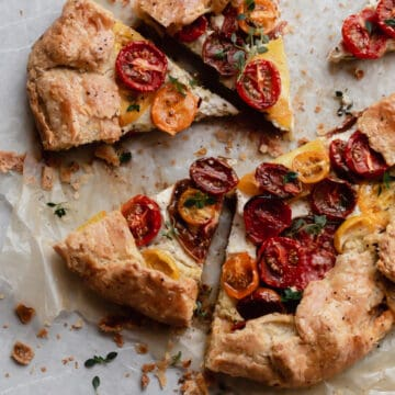 Baked and sliced heirloom tomato galette with ricotta, pistachio pesto and a flaky, buttery pie crust